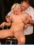 Short haired blonde with small tits and hairless pussy getting some pain
