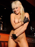 Perfect boobed blonde babe Syren Sexton shows off her sexy nude body at a bar