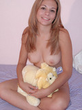 Little smiley shows her breasts