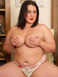Hot big brunette Pandora strips down to her underwear with fire in her eyes