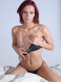 Red haired tranny strips black lingerie showing her tiny tits and wanking off he