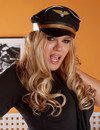 Fair haired transsexual stewardess sporting sexy black stockings and dress