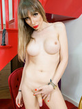 Flirtatious shemale with firm tits uses a black toy on her ass and displays her dick