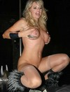 Voluptuous blonde stripper performs a crazy show by the pole and dildos her cunt