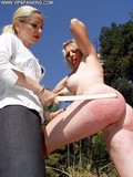 Brunette and blonde get completely naked and take spanking right in the sun