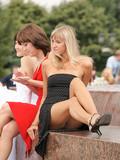 Beautifully dressed leggy blonde caught flashing her panties in public