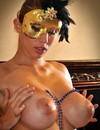 Curvacious masked brunette beauty Leila poses nude showing off her giant sexy ti