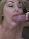 Cum hungry mature lady swallows jizz after stroking and sucking a thick cock