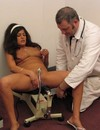 Brunette girl enjoys vibrator and fucking machine in front of a doctor