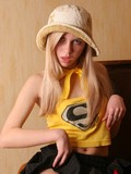 Flirtatious blonde teen in hat and pretty short black skirt flashes her young ass