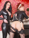 Brunette mistress dominates female