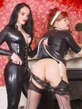 Brunette mistress dominates female