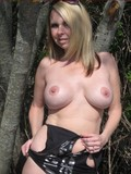 Shameless chubby mature woman walks over the country road absolutely naked