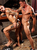 Two inked up hunks have oral fun and enjoy hardcore anal sex at the bar
