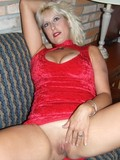 Big boobed blonde milf in short red dress exposes her sexy hairless pussy