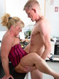 Horny mature slut gets her meaty pussy fucked with condom in the kitchen