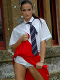 Nasty college girl Sandra in red skirt flashes her panties and gives blowjob in
