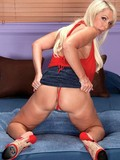 Pretty faced blonde MILF Alysha with big melons stripping in the bedroom